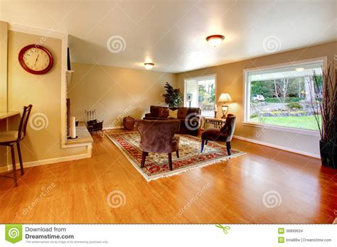 warm color furnished living room with wide windows