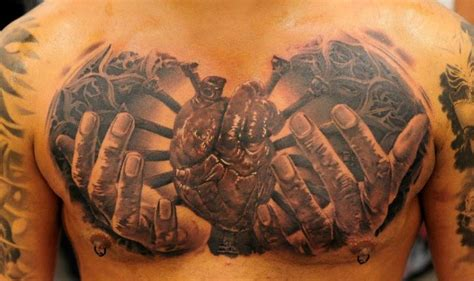 tattoo chest hand realistic chest heart hand tattoo by radical ink