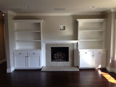built in cabinets around fireplace for the home
