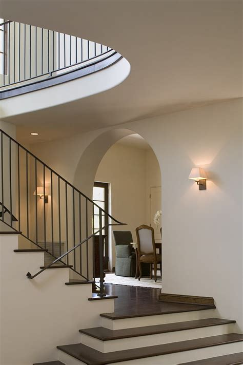 dark wood banister stair railing ideas staircase contemporary with artwork baseboards concrete floating