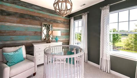 Turquoise blue and gray nursery design with round crib country nursery