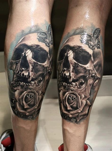 skull and rose back leg tattoo