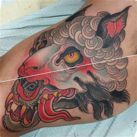 wolf in sheeps clothing tattoo wolf in sheeps clothing inner arm by chong tramontana