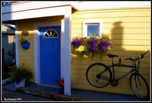 yellow house with blue door yellow house with a blue door flower box and bike flickr