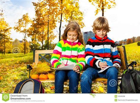 blond twins afterschool   park stock photo image