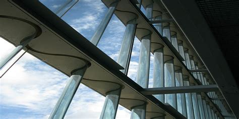 Home Design Engineer designing and constructing corrugated glass facades