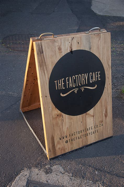 Coffee Shop Signage Design | an a frame sign made from old pallet wood designed for