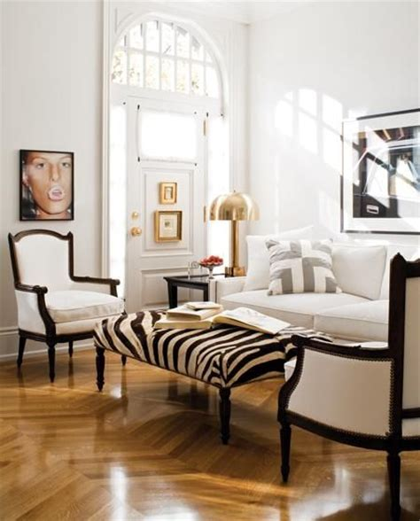 love the ottoman and dark wood floor and wall color black white gray gold living room chevron floors zebra