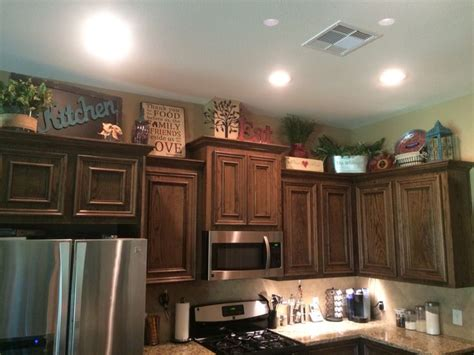 decorating ideas for kitchen cabinets best 25 above cabinet decor ideas on top of