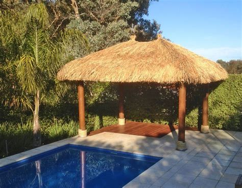 backyard living with thatched roof gazebo aarons outdoor