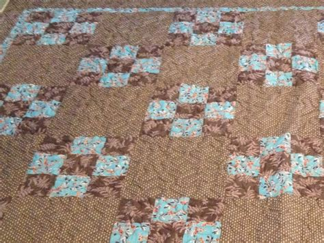 brown and teal 9 patch quilt quilts brown beige
