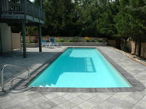 how big is a lap pool what should be the dimensions and cost of a small lap pool