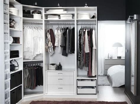 ikea pax closet system in white set up bedroom