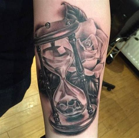 hourglass and rose tattoo grey and skull in hourglass on sleeve