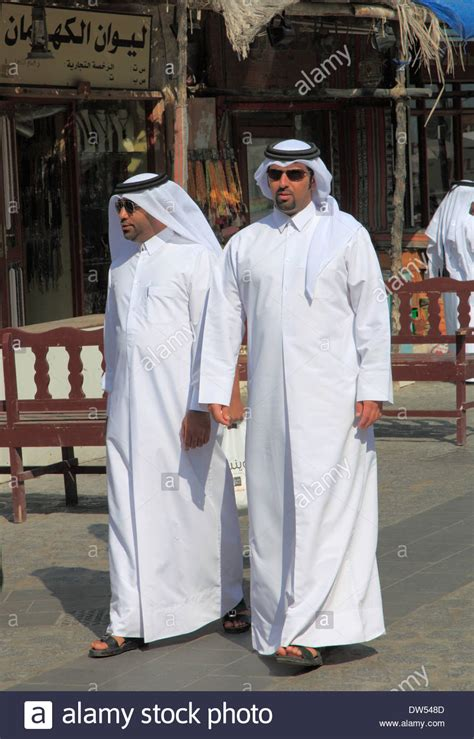 men long hair doha qatar qatar doha souq waqif street scene people men stock