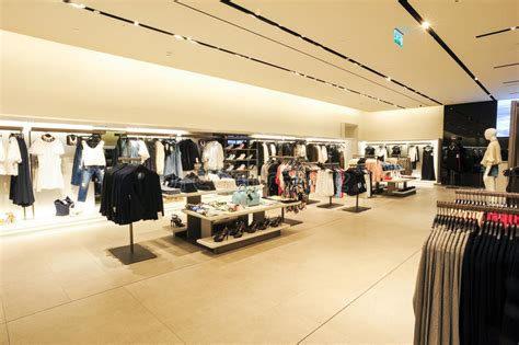17 best ideas about zara store on zara trousers topshop and zara interior of zara fashion clothes store editorial stock