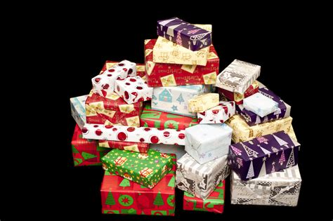 photo of pile of colorful christmas gifts on black free