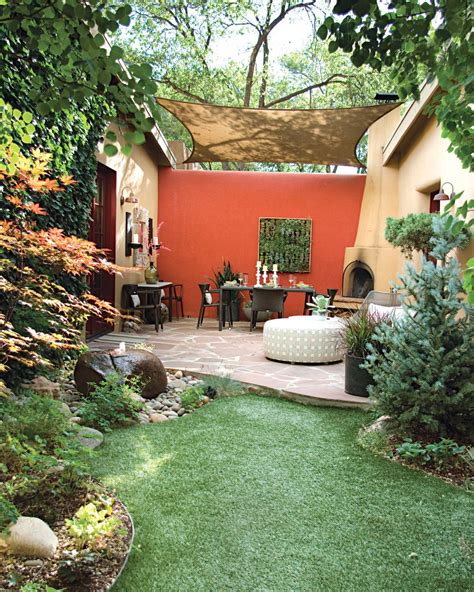 small yard living and landscaping burst of color the bright orange back wall adds distinction to this space at the far end of a garden