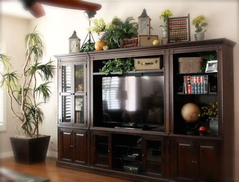 Decorating Ideas For Top Of Armoire by Top Of Large Entertainment Center Decorating Ideas