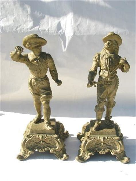 pair of vintage finish cast faux bronzes pair of vintage cast spelter cavalier figures antique gold finish