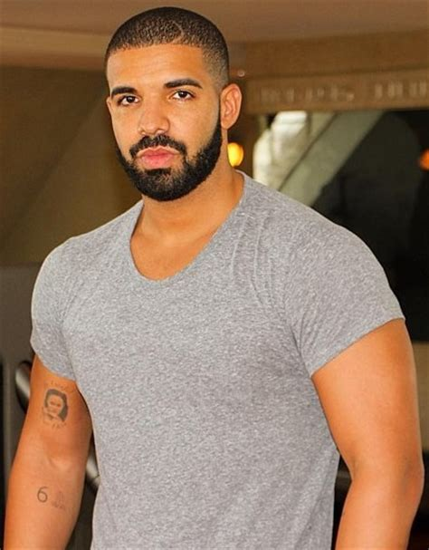 drake s mysterious arm tattoo may be a portrait of rihanna