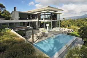Picture of modern villa with the pool as seen from the hill right next