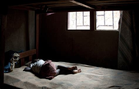 alone in bed orphans and vulnerable children rwanda photography of