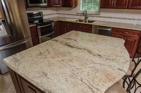 Kitchen Classics Cabinets golden ivory granite with cherry cabinets traditional