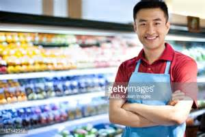 sales clerk in supermarket stock photo getty images