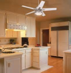 Glossy white ceiling fan subtly accents this white kitchen picture