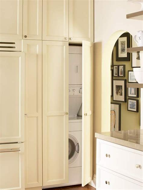 cabinet doors to hide washer and dryer washer and dryer hidden behind cabinet doors laundryroom