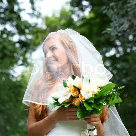 Beautiful red hair bride wearing     Stock Photo   Colourbox