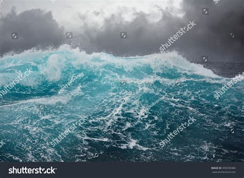 wavestormthegrease com dark clouds and crashing ocean waves during storm in the