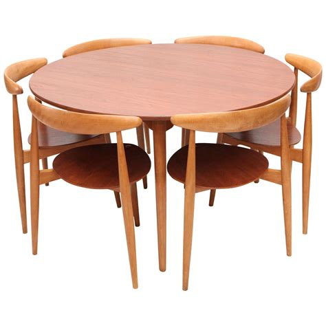 hans wegner three leg table with matching three leg chairs