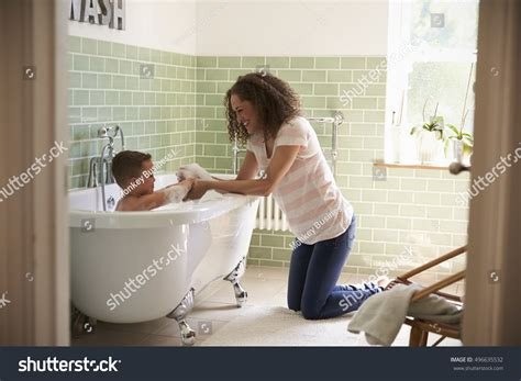 mom bathroom mother son having fun bath time stock photo 496635532