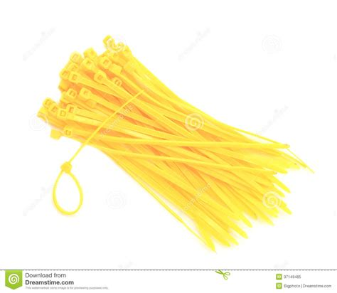 yellow cable ties isolated against white background