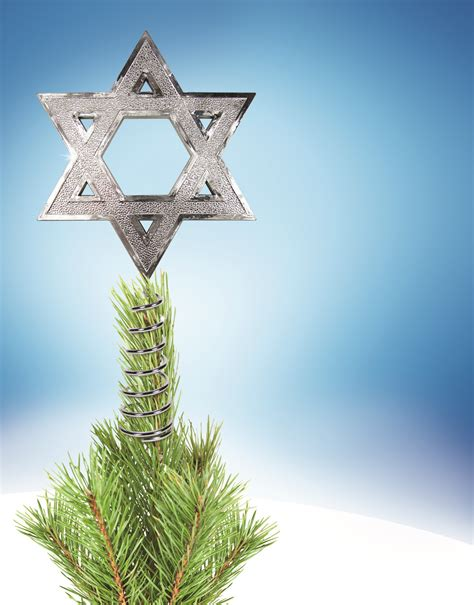 jewish star christmas tree topper oy tannenbaum the hanukkah tree topper telegraphic agency