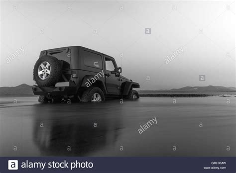 white jeep stuck in mud jeep wrangler road stock photos jeep wrangler
