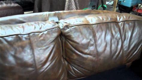 clifton nj badly faded and damaged aniline leather sofa