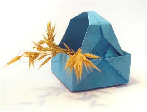 Origami Figure - origami figure of blue basket with ears stock photo