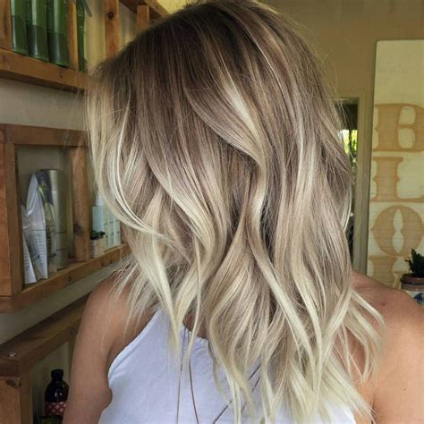 mid length balayage wavy mid length cafe au lait colored hair with creamy