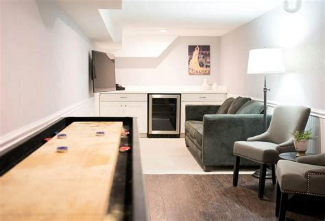 Lovely Home Movie Room Decor #7: Small-man-cave-with-home-bar-couch-and-shuffleboard-table.jpg