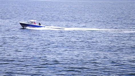 fast boat ocean high angle of view of a fast boat in the middle of the