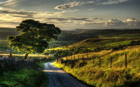 sunset villages road field grass hill fence trees