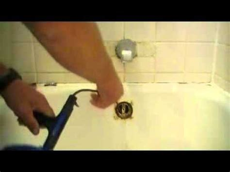 bathtub drain clog snake how to snake out a bathtub drain youtube