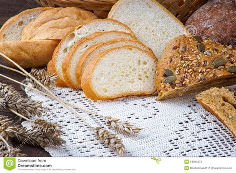 Handmade White Bread - sliced handmade white bread on a tablecloth stock photo