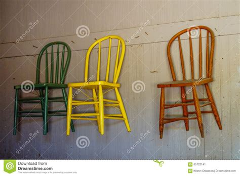 Hanging Folding Chairs On Wall by Antique Chairs Hanging On Wall Stock Photo Image 65722141