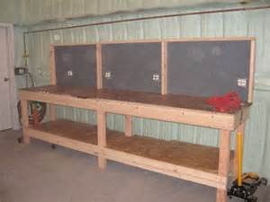 long work bench garage work bench add peg board painted red on the back side for tool storage diy