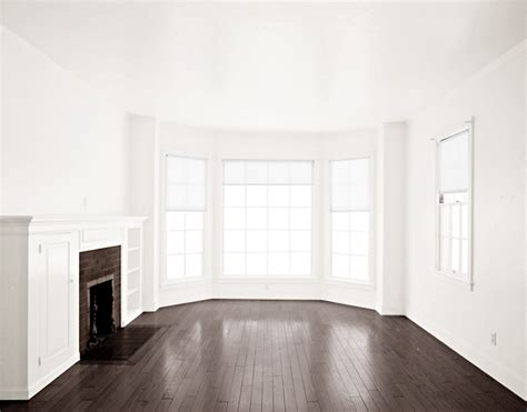 what to do with an empty room in your house empty room dark brown floor fireplace white by