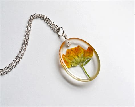 resin flowers for jewelry pressed flower necklace real flowers in clear resin yellow